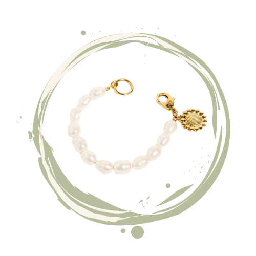 Freshwater pearl bracelet with sunflower gold charm accent.